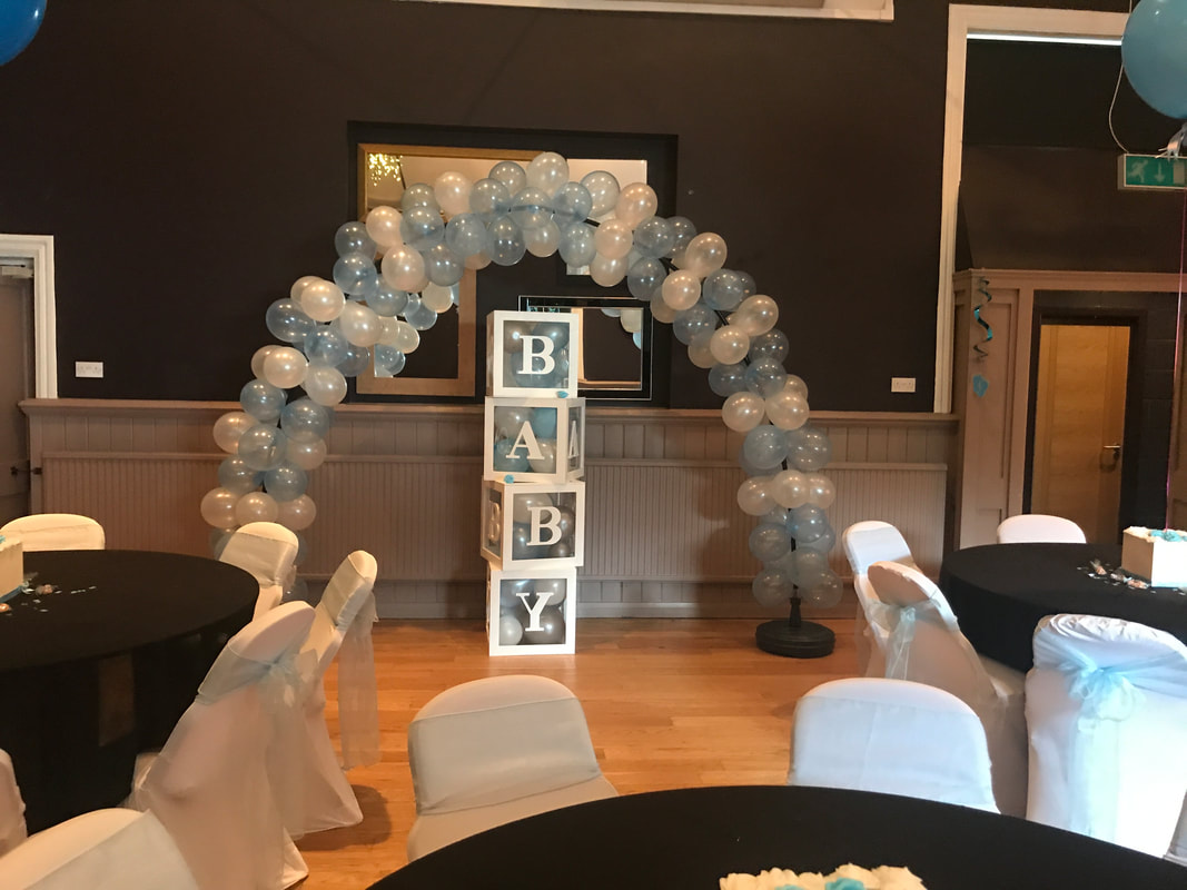 Organic balloon arch and baby boxes for a baby shower