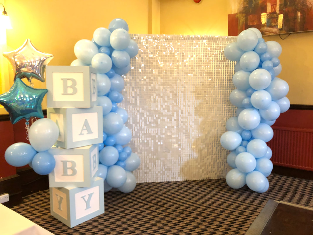 White sequin with organic balloon arch for baby shower