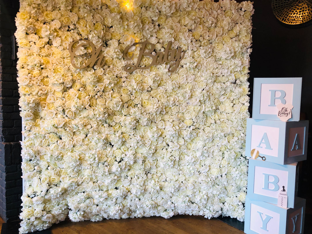 Baby shower decoration in london, flower wall and baby boxes